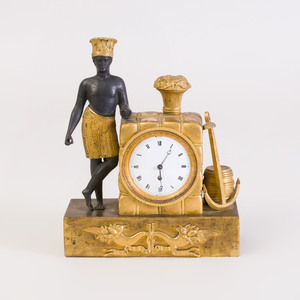 Charles X Parcel-Gilt Bronze Clock with Figure Emblematic of North America