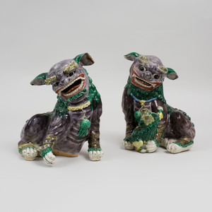 Pair of Chinese Aubergine, Green and Yellow Glazed Porcelain Models of Buddhistic Lions