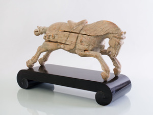 HAN STYLE CARVED AND PAINTED WOOD FIGURE OF A RUNNING HORSE