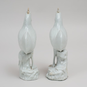 Pair of Chinese White Glazed Pottery Figures of Roosters on Rockwork