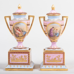 Pair of Vienna Porcelain Pink Ground Urns and Covers Decorated with Mythological Scenes