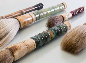 GROUP OF SIX CHINESE JADE, HARDSTONE, BAMBOO AND BONE FLY WHISKS