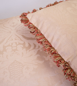 PAIR OF SILK DAMASK PILLOWS WITH PASSEMENTERIE EDGE