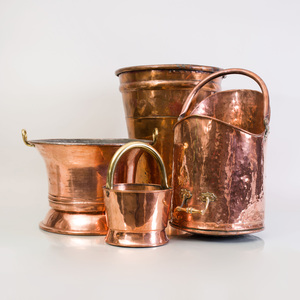 Large Copper Tapered Cylindrical Bucket, a Copper Scuttle, a Two-Handled Beaker Bucket and a Small Bucket with Brass Swing Handle