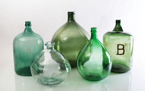 GROUP OF FIVE LARGE GLASS STORAGE BOTTLES