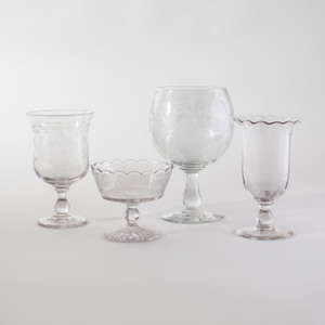 Group of Four Colorless Glass Table Articles