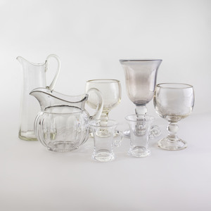Seven Colorless Glass Table Articles
