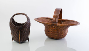 TWO WOVEN RATTAN OVERHANDLE BASKETS