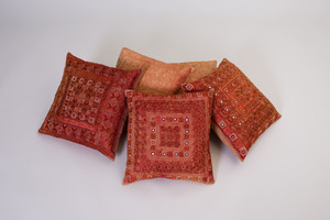 SET OF THREE AND A PAIR OF EMBROIDERED PILLOWS