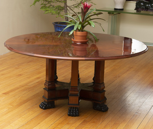 CUSTOM MADE EMPIRE STYLE MAHOGANY CIRCULAR DINING TABLE WITH EBONIZED PAW FEET