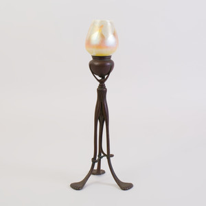 Tiffany Studios Patinated-Bronze Tripod Candlestick and a Favrile Glass Shade