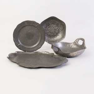 Group of Four Art Nouveau Pewter Dishes and a Lotus Form Brass Bowl