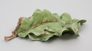 Three Vladimir Porcelain Leaf-Shaped Dishes and a Limoges Trompe L'Oeil Dish