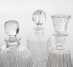 Two Baccarat Glass Decanters and Stoppers, and Five Glass Decanters and Stoppers