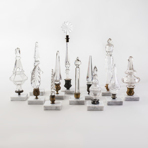 Group of Twelve Cut and Molded Glass Finials Mounted on Marble Bases