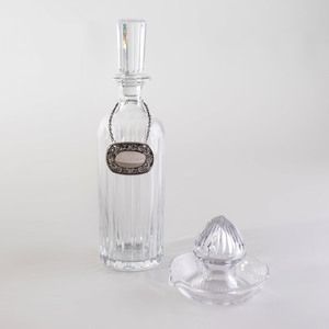 Baccarat Glass Decanter and Stopper, a William Yeoward Citrus Juicer, and a Silver Plate Bottle Ticket