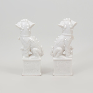 Pair of Chinese White Glazed Porcelain Models of Buddhistic Lions and a White Glazed Porcelain Model of a Hound