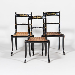 Three Regency Style Metal-Mounted Ebonized and Caned Side Chairs