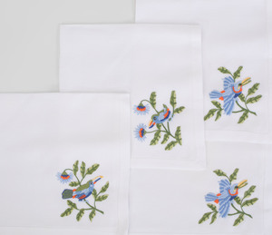 Hermes Circular Linen Tablecloth and a Set of Twelve Napkins Embroidered with Toucans