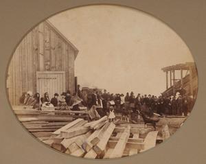 AMERICAN SCHOOL (C. 1890): CONSTRUCTION SITE WITH MEN, WOMEN AND CHILDREN