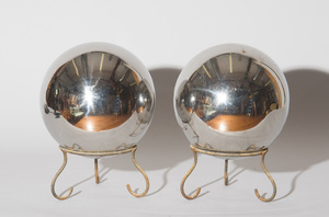 TWO GLASS GARDEN GAZING BALLS ON WROUGHT IRON STANDS