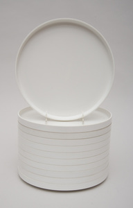 GROUP OF ELEVEN WHITE MELAMINE STACKING PLATES, DESIGNED BY MASSIMO VIGNELLI FOR HELLER