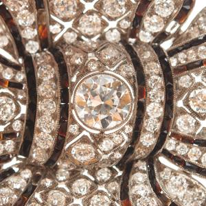 French Art Deco Platinum, Diamond and Black Onyx Bow Brooch