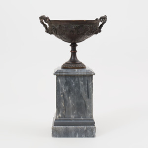 Continental Neoclassical Bronze Urn with Fruiting Vine Motif on a Grey Marble Base