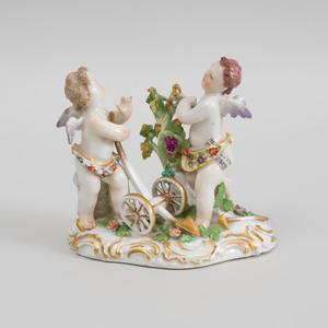 German Porcelain Putti Group Emblematic of Autumn