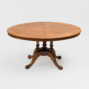 Victorian Carved and Inlaid Walnut Oval Center Table, possibly Continental