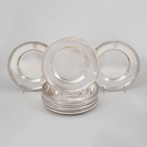 A Set of Twelve Gorham Silver Bread and Butter Dishes