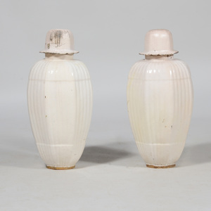 Pair of White Glazed Pottery Jars and Covers