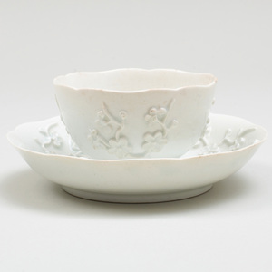Bow White Glazed Porcelain Teabowl And Saucer with Applied Prunus Decoration