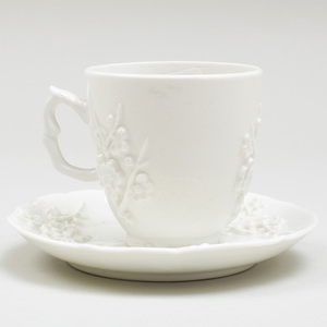 Bow White Glazed Porcelain Coffee Cup and Saucer with Applied Prunus Decoration