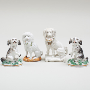 Four Continental Porcelain Models of Dogs