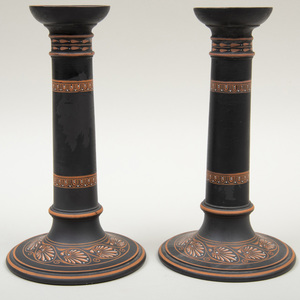 Pair of Wedgwood Black Basalt Encaustic Decorated Candlesticks