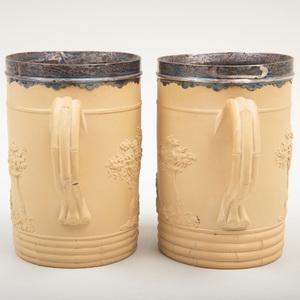 Two Wedgwood Caneware Silver-Mounted Mugs