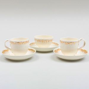 Pair of Wedgwood Gilt-Decorated Creamware Cups and Saucers and a Teabowl and Saucer