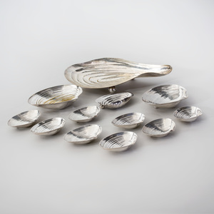 Group of Eleven Silver and Silver Plate Shell Form Dishes