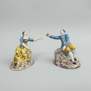 Pair of Dutch Polychrome Delft Figures of a Seated Gallant and Companion