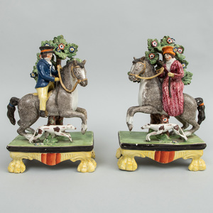 Pair of Staffordshire Pearlware Equestrian Bocage Groups of a Huntsman and Companion