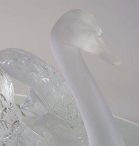 Pair of Lalique Frosted and Molded Glass Swans and an Etched Mirror Glass Base