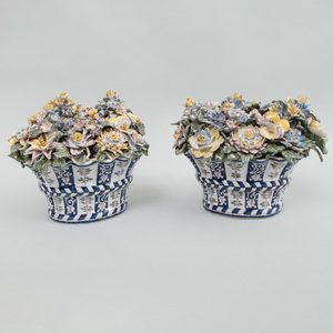 Pair  of Continental Faience Demilune Baskets of Flowers