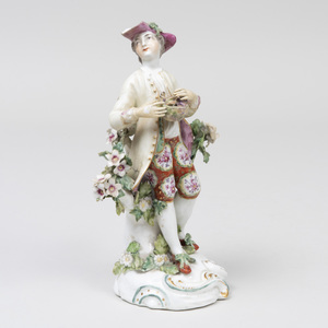 Derby Porcelain Figure of a Shepherd Holding a Bird's Nest