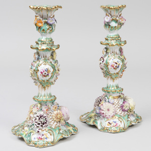 Pair of English Porcelain Flower Encrusted Green Ground Candlesticks