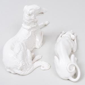 Two Nymphenburg Porcelain White Glazed Models of Recumbent Hounds