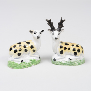 Pair of Staffordshire Pearlware Pottery Models of a Recumbent Stag and Doe