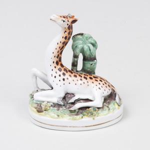Staffordshire Pottery Figure of a Recumbent Giraffe