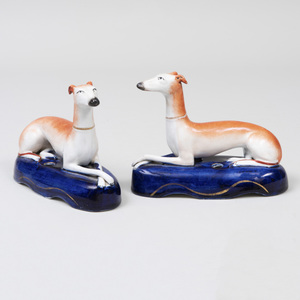 Pair of Staffordshire Pottery Quill Holders in the Form of Recumbent Greyhounds