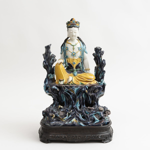Chinese Aubergine, Turquoise, Yellow and Green Glazed Porcelain Figure of Seated Guanyin